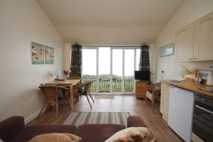 self catering chalet lounge with view to beach